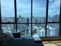 Comfortable sofa in living area with a nice view of Bangkok